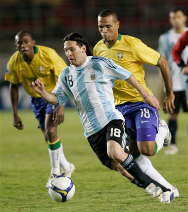 Brazil's Luis Fabiano tries to contain Argentina's Lionel Messi in a World Cup qualifier