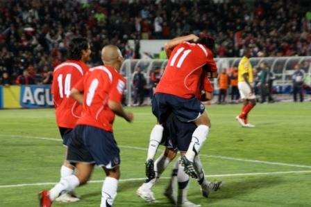 Chile's players celebrate after scoring a goal in the world cup qualifiers
