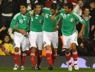 Mexico's players celebrate a goal against Ghana