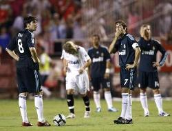 Real Madrid players reacting in despair after Sevilla scores in a 2-1 La Liga defeat to Los Nervionenses.