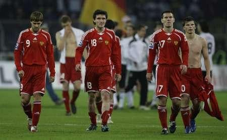 Russian players walk off the field after their 2-1 defeat against Germany in a World Cup qualifier