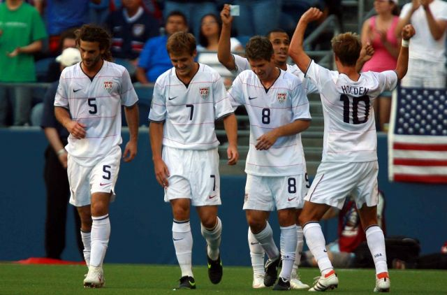 The USA national football team celebrate a goal against Grenada