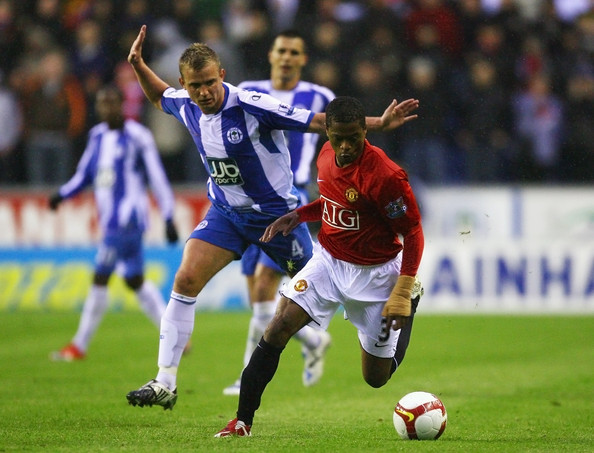 Manchester United's Patrice Evra in action against Wigan Athletic