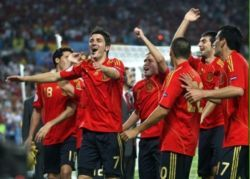 Spain's national football team celebrating after a goal scored by David Villa