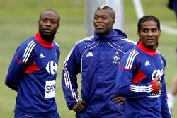 France's William Gallas, Djibril Cisse, and Florent Malouda pictured during a training session.