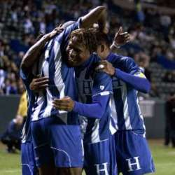 Honduras players unite in celebration.