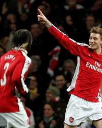 Bendtner celebrates with Arsenal