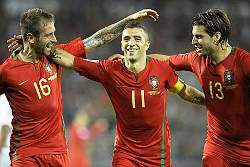 Portugal's deputy captain Simao celebrates with his mates.