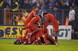 Portugal players celebrate their qualification into the 2010 FIFA World Cup.