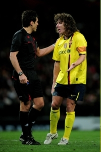 Carlos Puyol against Arsenal for Barcelona at the Emirates in the  Champions League