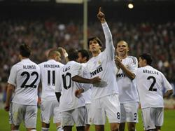 Kaka goes in front of the crowd to celebrate after scoring, he is aided by the rest of his Real Madrid team mates.