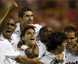 Sevilla players erupt in joy as the celebrate their goal against Real Madrid.