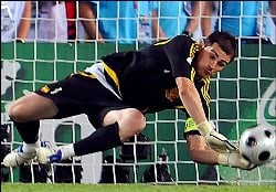 Spain's Iker Casillas saves a penalty against Italy.