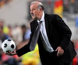 Spain Coach Vicente del Bosque ready to give out a ball to the players on the pitch.