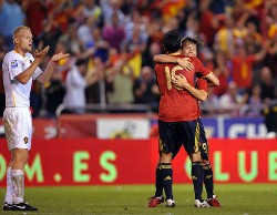 Spain's Alvero Arbeloa celebrating with a team mate as he scores his side's fifth goal against Belgium.
