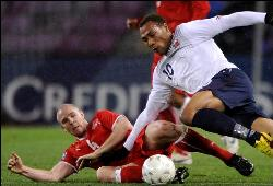 Switzerland's Senderos in action against Norway.