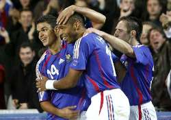 France's Thierry Henri congratulated by his mates as he scores a goal for his side.