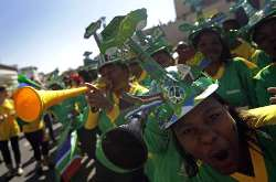 South African fans march and blow Vuvuzela horns in support of Bafana Bafana.